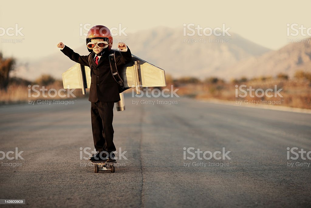 Young Boy Wearing Business Suit and Jet Pack stock photo