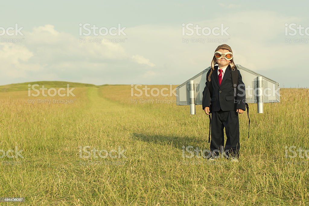 Young Boy Wearing Business Suit and Jetpack stock photo