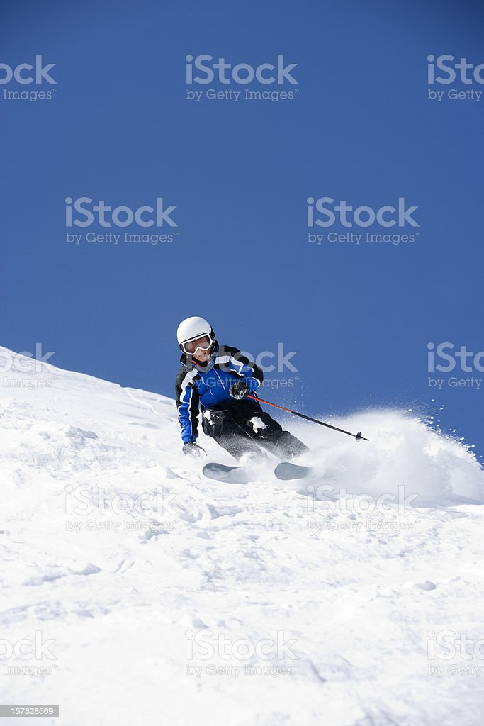 Young Boy wearing helmet while snow skiing stock photo