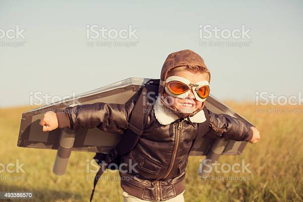 Young boy wearing jetpack is taking off picture id493386570?b=1&k=6&m=493386570&s=612x612&h=ipegypgcfozm3wpwufyqpdg ke98sidqnpwoizf vfy=