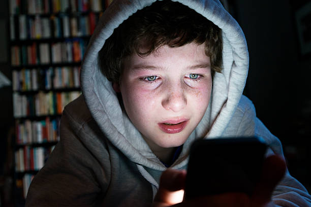 young boy who is the victim of online bullying - kids online abuse stockfoto's en -beelden