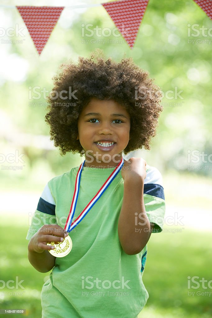 Young Boy Winning Medal At Sports Day stock photo