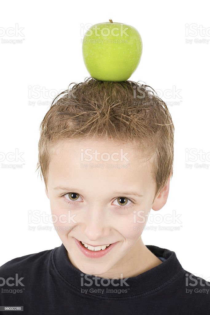 young boy with a green apple on the head royalty-free stock photo