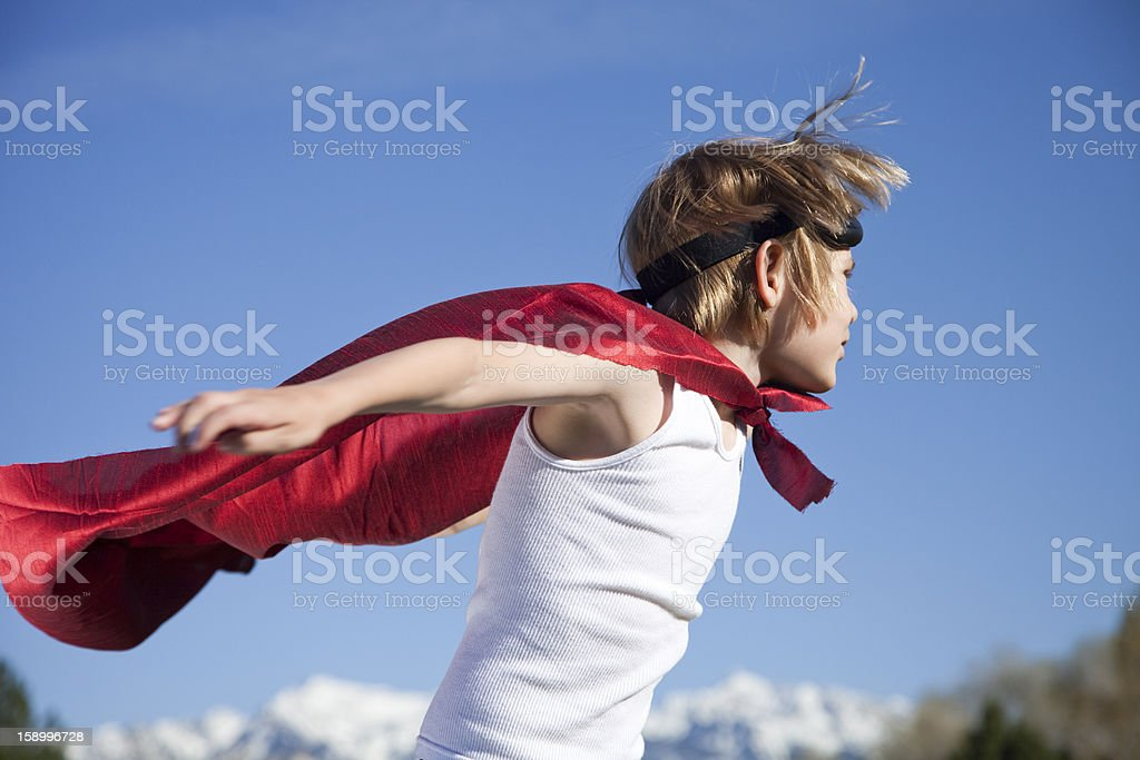 Young boy with a red cape and hero mask royalty-free stock photo