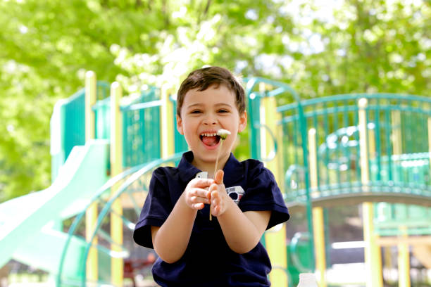 Young boy with autism laughing stock photo