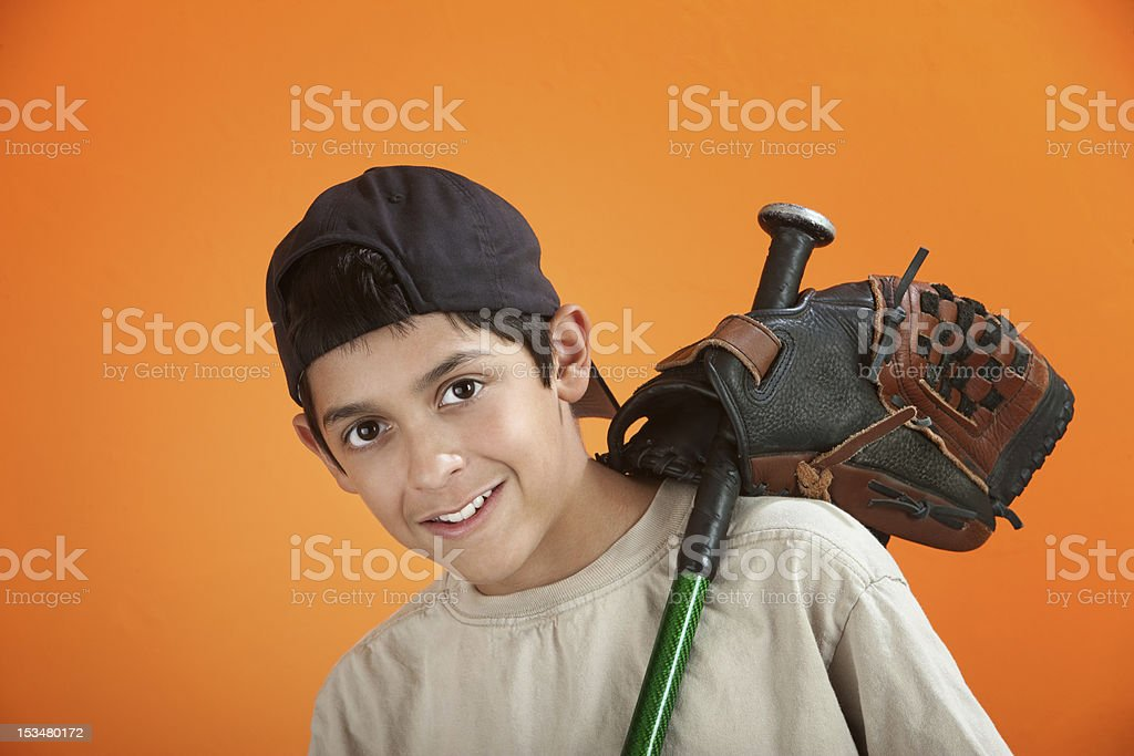 Young boy with baseball glove and bat royalty-free stock photo