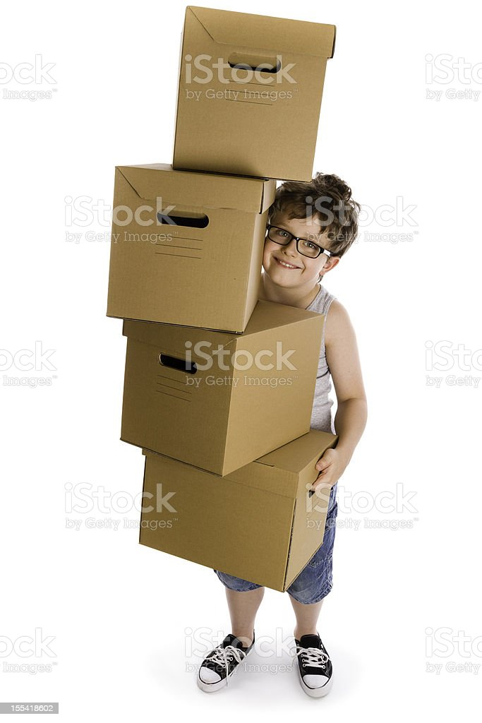 young boy with boxes royalty-free stock photo