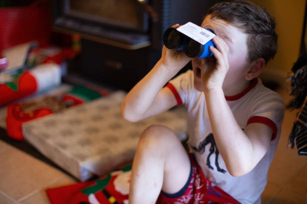 Young boy with Christmas presents stock photo