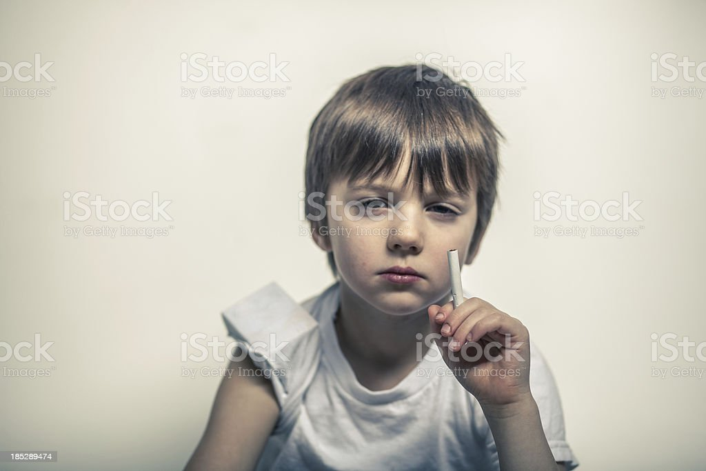 Young Boy with Cigarette in Hand, Pack Under Sleeve royalty-free stock photo
