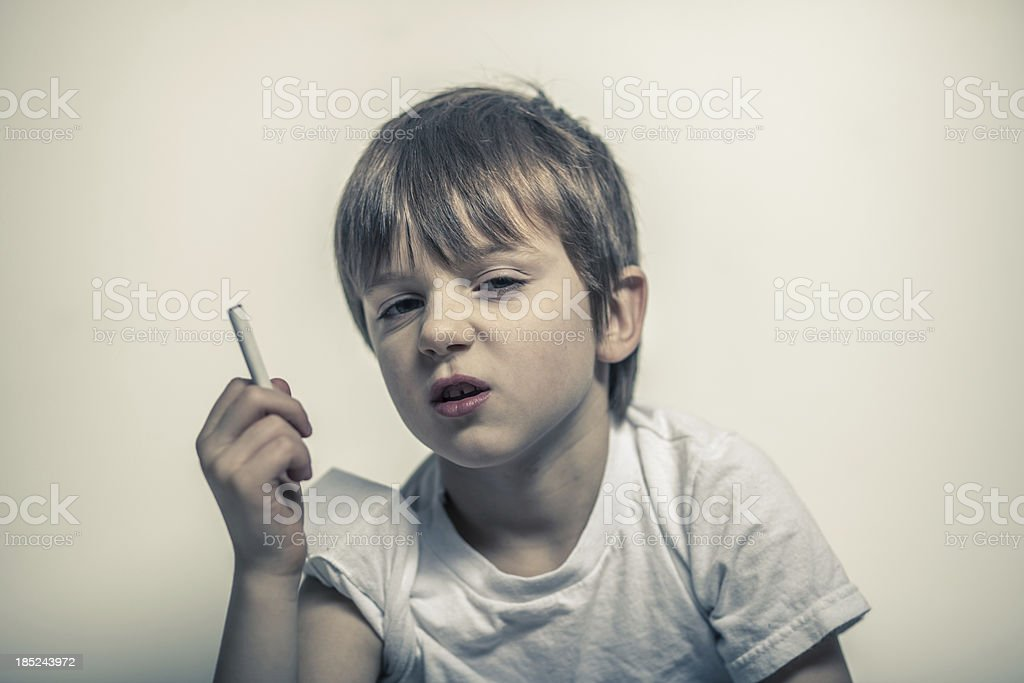 Young Boy with Cigarette in Hand, Shifty Eyes royalty-free stock photo