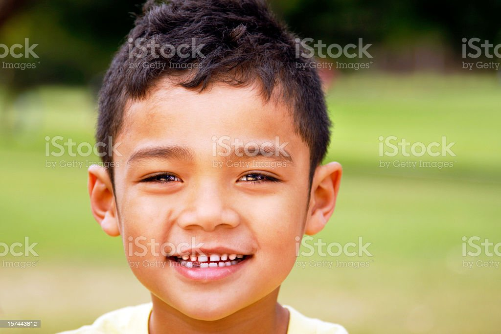 Young boy with dark hair and a missing tooth royalty-free stock photo