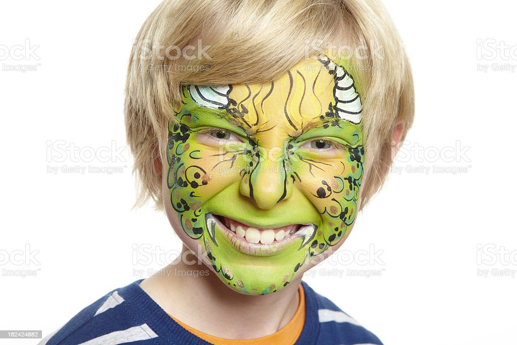 Young boy with face painting monster stock photo