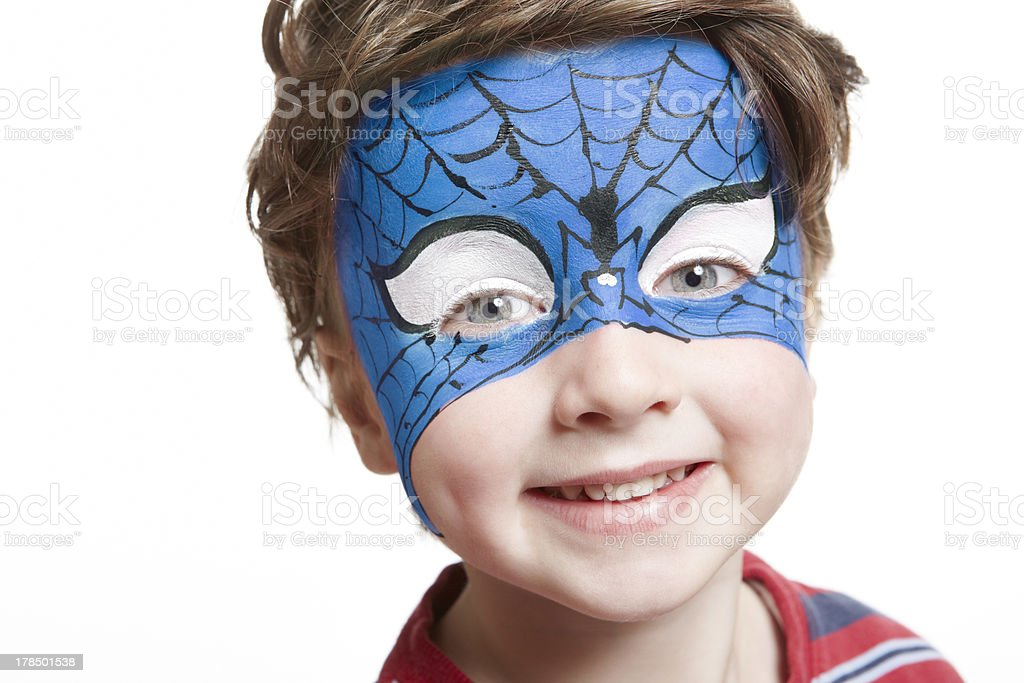Young boy with face painting superhero stock photo