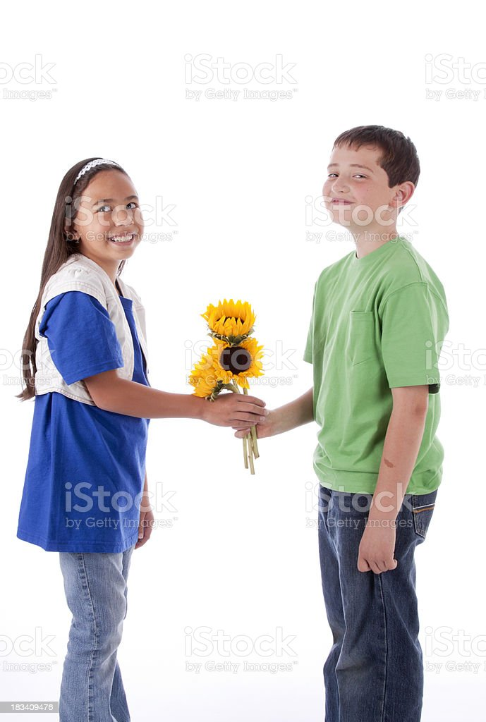 Young Boy With Flowers for a Girl stock photo