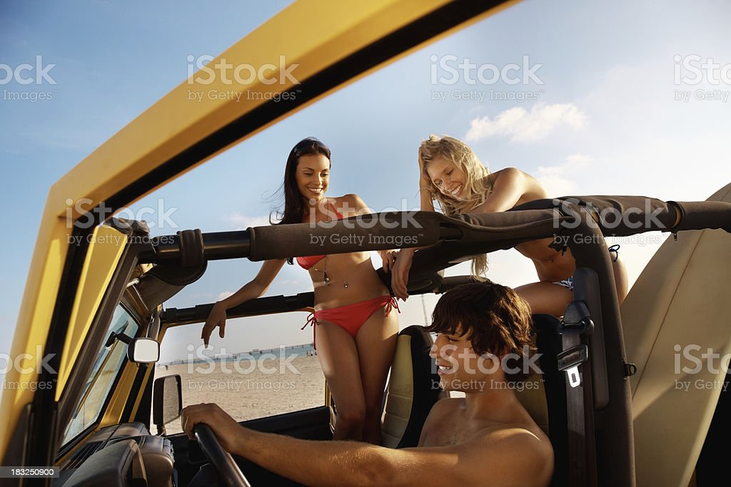 Young boy with friends in jeep enjoying their vacation royalty-free stock photo