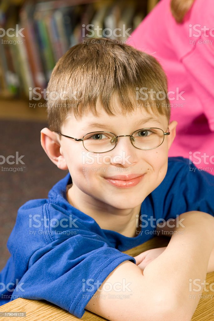 Young boy with glasses smiling at camera royalty-free stock photo