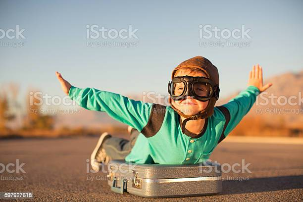 Young boy with goggles imagines flying on suitcase picture id597927618?b=1&k=6&m=597927618&s=612x612&h=f e2ctjv6x8z5iubs1aookqkezgefhcnm1p3jvdlzry=