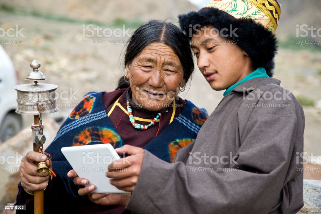 Young boy with grandmother using digital tablet stock photo
