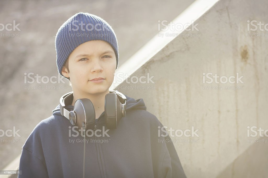 Young boy with headphones in vintage look stock photo