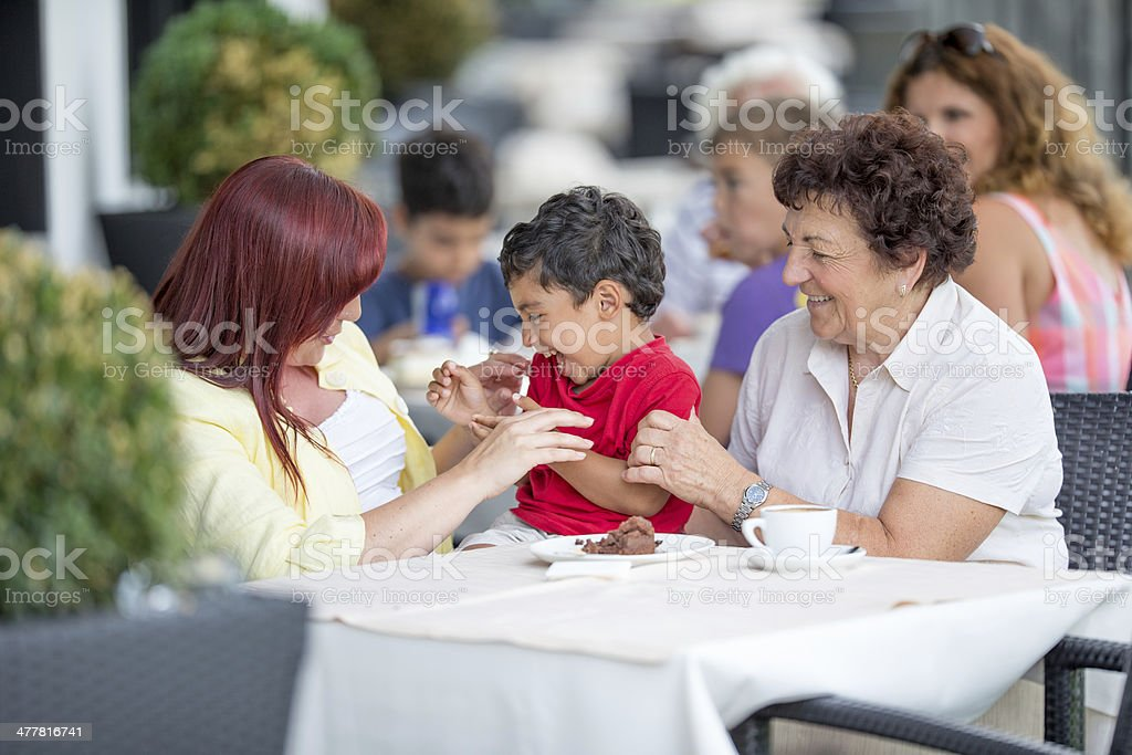 Young boy with his mother and grandmother royalty-free stock photo