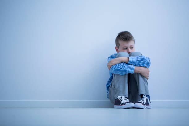 young boy with hypersensitivity - autism stock photos and pictures