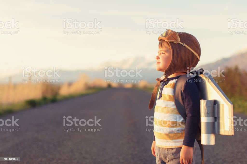 Young Boy with Jet Pack Dreams of Flying stock photo