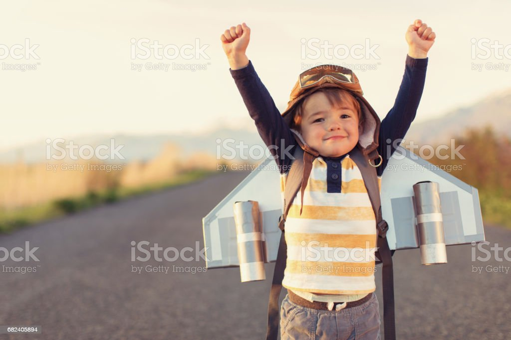 Young Boy with Jet Pack with Arms Raised