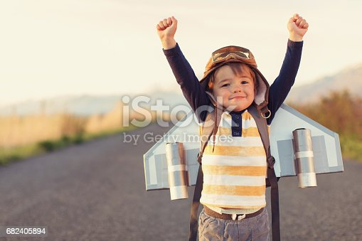 istock Young Boy with Jet Pack with Arms Raised 682405894