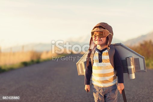 istock Young Boy with Jet Pack with Flying Goggles On 682405880
