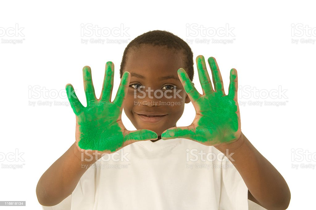 Young boy with painted green hands royalty-free stock photo
