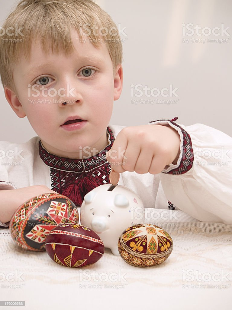 Young boy with piggi bank stock photo