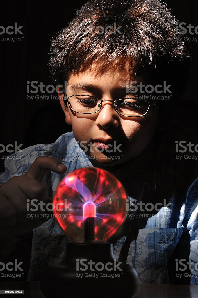 Young boy with plasma lamp toy stock photo