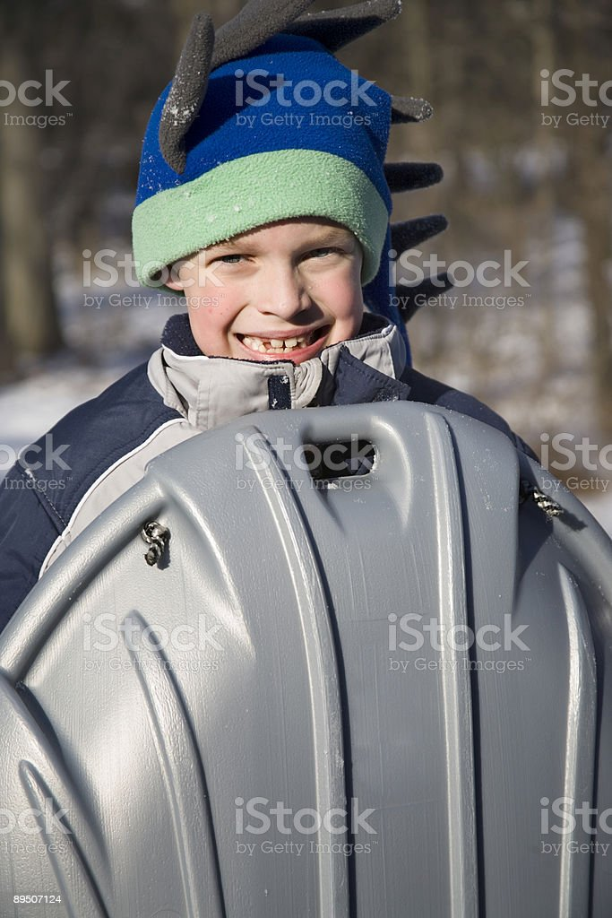 Young Boy with Sled royalty-free stock photo