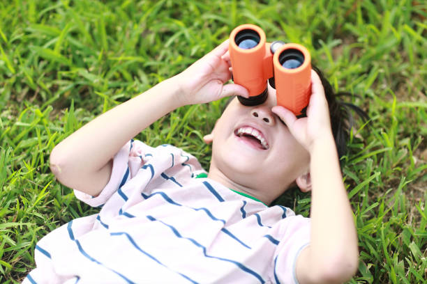 Young boy with telescope stock photo