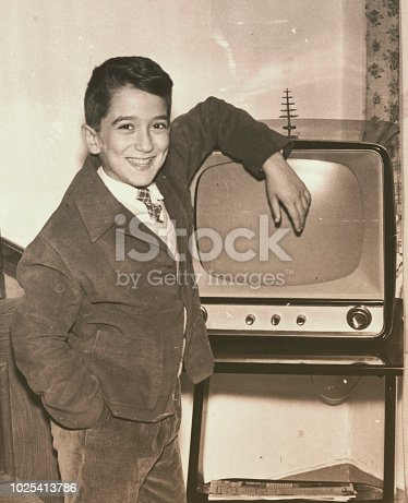 istock 1957 young boy with television 1025413786