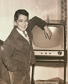 1957 young boy with television