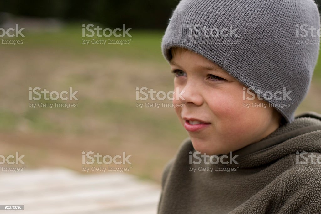 Young boy with togue looking into distance stock photo