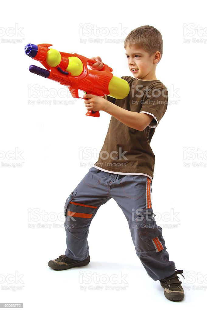 Young boy with water gun stock photo