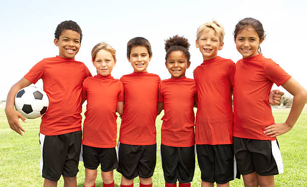 Young Boys And Girls In Football Team stock photo