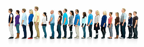 Young boys and girls standing in a line stock photo