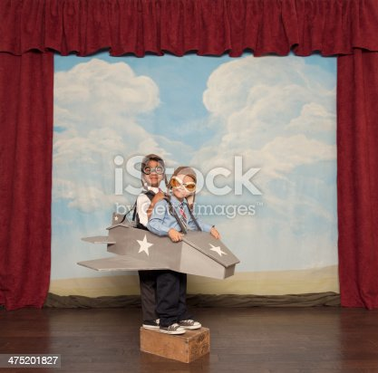 istock Young Boys and Pilots Flying Toy Plane 475201827