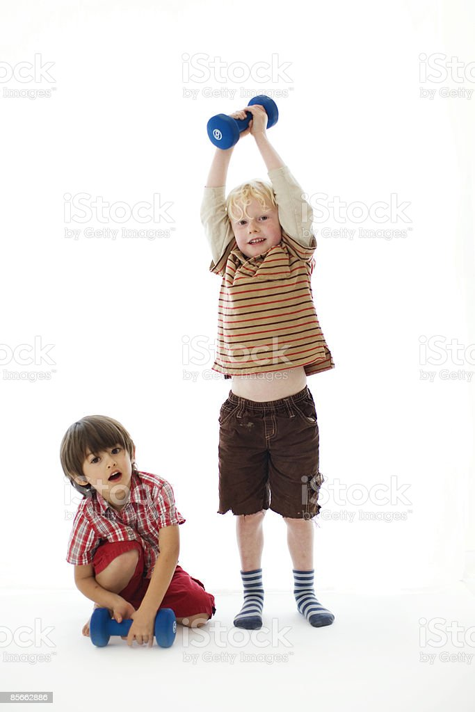 Young boys exercising with weights royalty-free stock photo