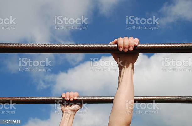 Young Boys Hands On Monkey Bars Stock Photo - Download Image Now