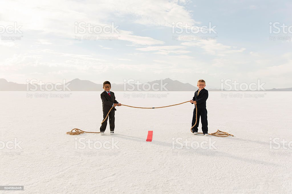 Young Boys Holding Business Tug of War stock photo