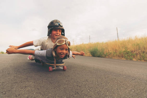 Young Boys Imagine Flying on Skateboard stock photo