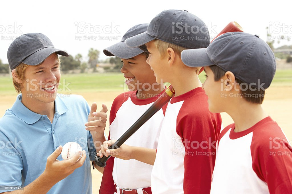 Young Boys In Baseball Team With Coach stock photo