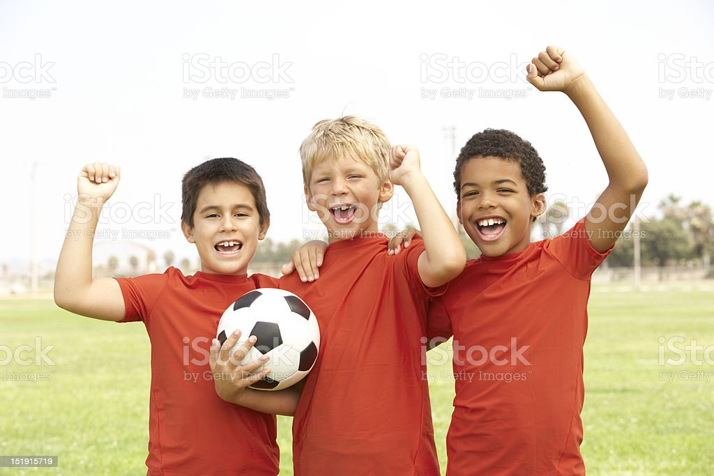 Young Boys In Football Team Celebrating stock photo