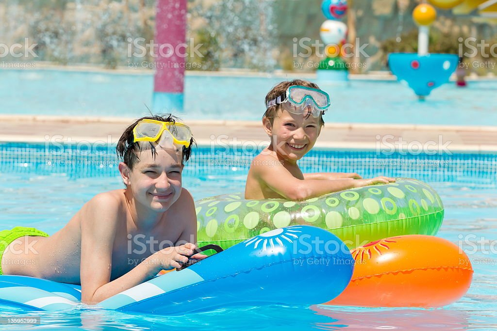 Young boys in swimming pool royalty-free stock photo