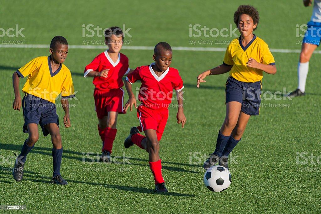 Young Boys Playing Football stock photo