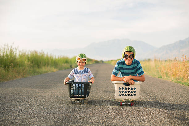 Young Boys Racing Wearing Watermelon Helmets stock photo